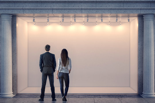 Man and woman looking at storefront