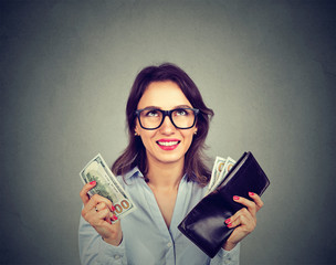 Happy woman taking money out of wallet