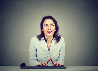 Surprised woman using a computer