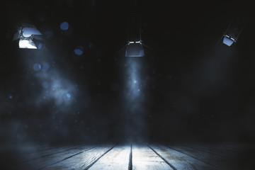 Three spotlight shining on stage