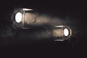 Two spotlights on smoky backdrop