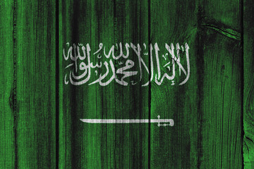 Saudi Arabia flag painted on wooden wall for background