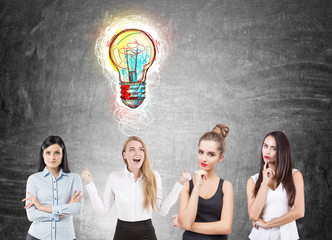 Four businesswomen brainstorming, ideas