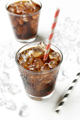 Cola with crushed ice in the glass on white background