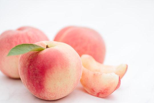 Fresh Japan White Peaches on White Background