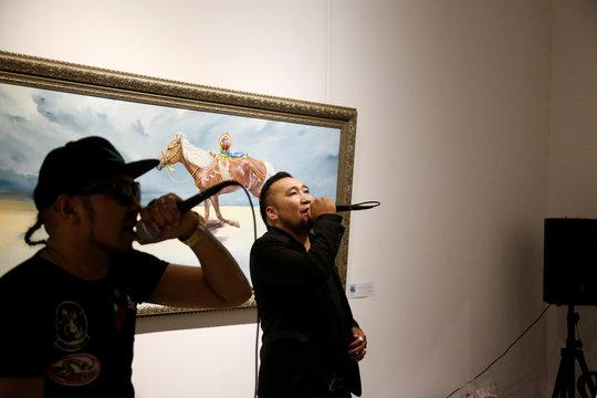 Hip pop singers Battogtokh Odsaikhan and Sanjjav Baatar of a band called Fish Symboled Stamp perform in an art gallery in Ulaanbaatar