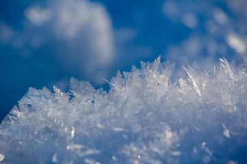 close up of the edges of frost formed on a snow hillock