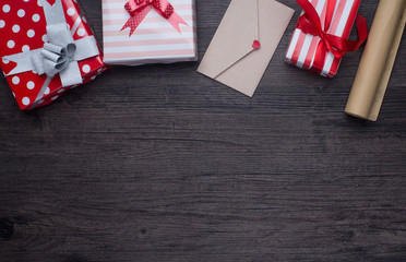 decorations and gift boxes on wooden board