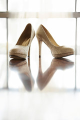 Gold shoes isolated on a white background.