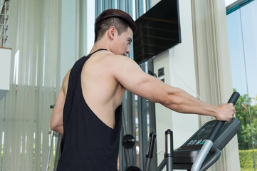 sport man is exercising on treadmill machine