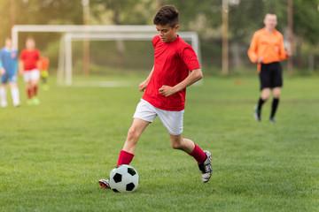 Kids soccer football - children players match on soccer field