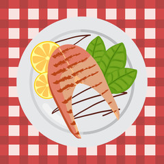 Grilled salmon on a plate with Basil and lemon