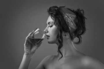young beautiful woman with glass of whiskey