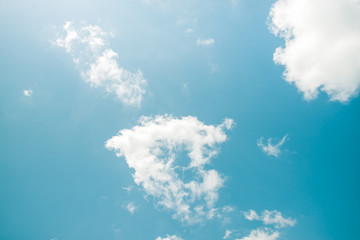 Fantastic soft white clouds against blue sky background