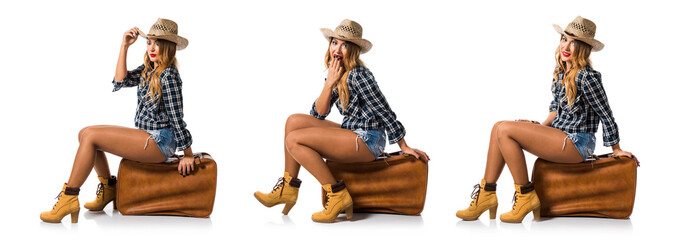 Sexy blonde woman cowgirl with vintage suitcase