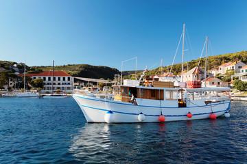 Tourist boat in the harbor of a small town Postira - Croatia, island Brac