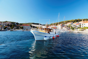 Tourist boat in the harbor of a small Postira town - Croatia, island Brac