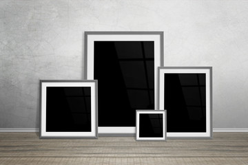 Multiple frames leaning on wall. Isolated for mockup.