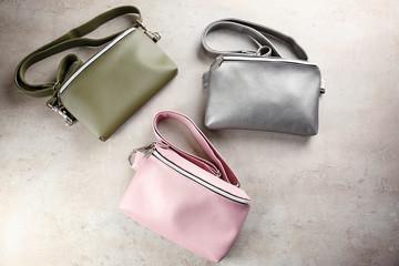 Leather handbags on light background