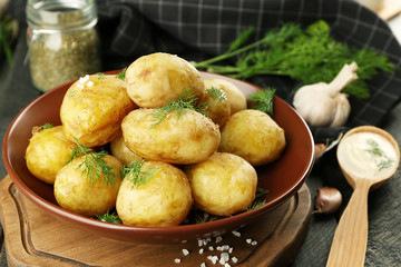 Composition with boiled potatoes on table, closeup