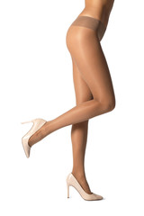 Legs of beautiful young woman in tights on white background