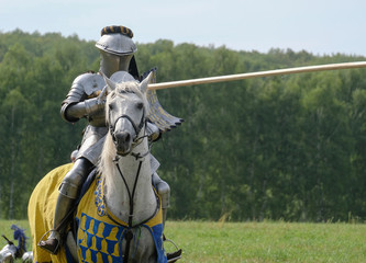 Medieval knight in armor on horseback
