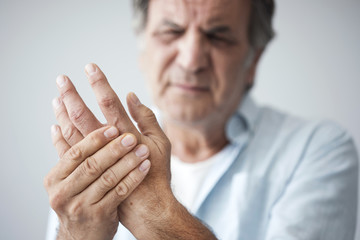 Old man with finger pain