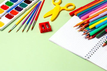 School background. Various school supplies on a desktop, copy space