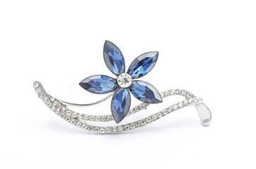 Wall Mural - Silver flower brooch isolated on white