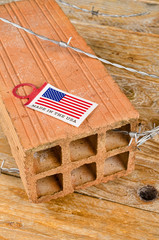 America first concept with brick and barbed wire
