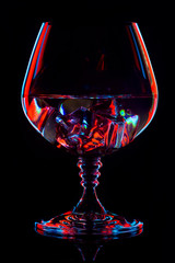 Silhouette glasses with drink in bar on black background