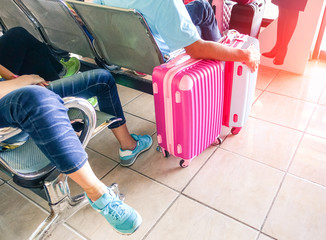Man hand holding luggage at airport passengers departures gate - Concept of travel lifestyle  and holidays