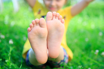 Children's feet on grass. picnic in park