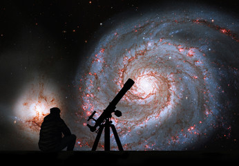 Man with telescope looking at the stars. Whirlpool Galaxy. Spiral galaxy M51 or NGC 5194.