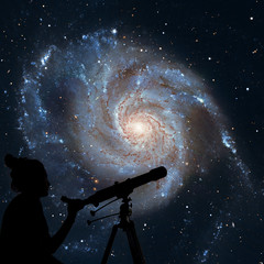 Girl looking at the stars with telescope. Pinwheel Galaxy Messier 101, M101 in the constellation Ursa Major.Elements of this image are furnished by NASA.