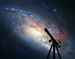 Space background with silhouette of telescope. Spiral Galaxy M106, in the constellation Canes Venatici.