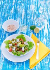 Fresh vegetable salad with feta cheese. Healthy food. Vegetable diet. Wooden board rustic