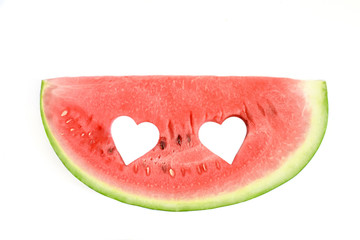 Fresh watermelon slice with carved hearts on white background