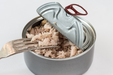 Tuna in the can on white background