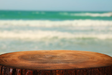 image of wooden table in front tropical sea background