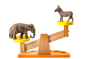 Democratic process and two party system concept with a donkey representing the democratic party in the USA and an elephant, a symbol of the American Republican party balancing on a balance scale