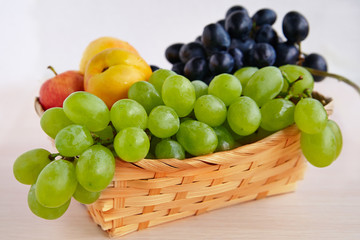 Grapes in a straw basket
