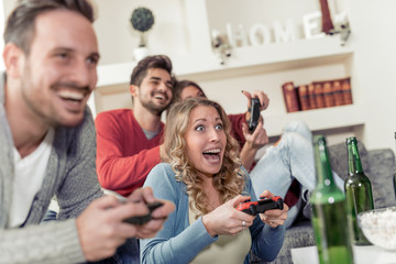 Happy couples playing video game at home
