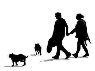 Couple out Walking two dogs Silhouette