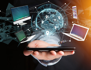 Computer and devices displayed on a futuristic interface with interantional network - Multimedia and technology concept