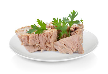 Canned tuna fish in plate on white background