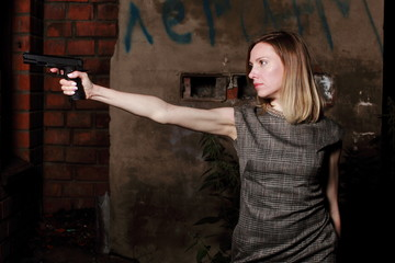 Woman with gun, night, outdoor.