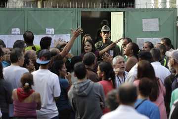 People wait to vote during the Constituent Assembly election in Caracas