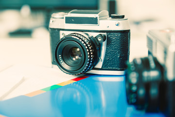 Old retro , vintage camera on vintage abstract background
