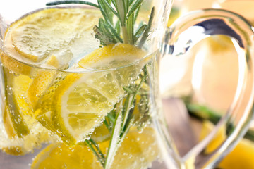 Jug of fresh lemonade with rosemary, close up